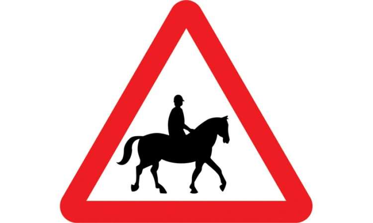 Accompanied horses or ponies likely to be in or crossing road ahead