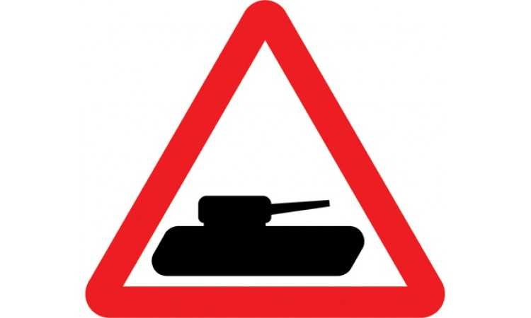 Slow moving military vehicles likely to be crossing or in the road