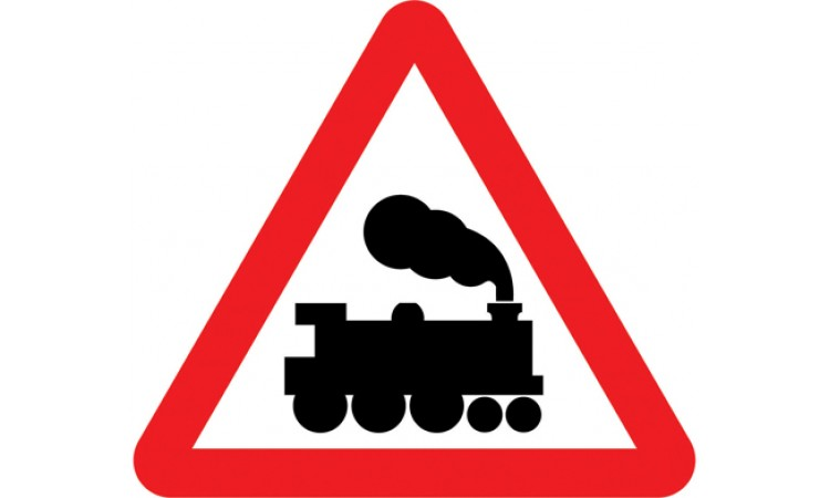 Railway level crossing without gate or barrier ahead